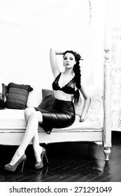 Model posing in elegant black skirt