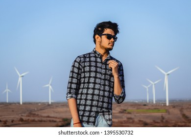 Model posing in front of the windmills in Wankaner, Gujarat, India