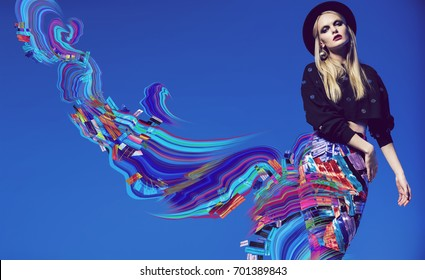 Model posing in multi striped skirt and abstract wave art on blue background