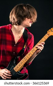 Model Red Flannel Shirt Playing Electric Guitar