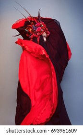Model in red floral head decoration