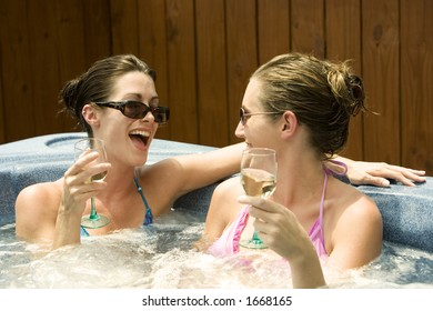 Model Release 353  Two women in their mid 20s enjoying a relaxing moment in a hottub