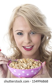 Model Released. Attractive Young Woman Eating Breakfast Cereals