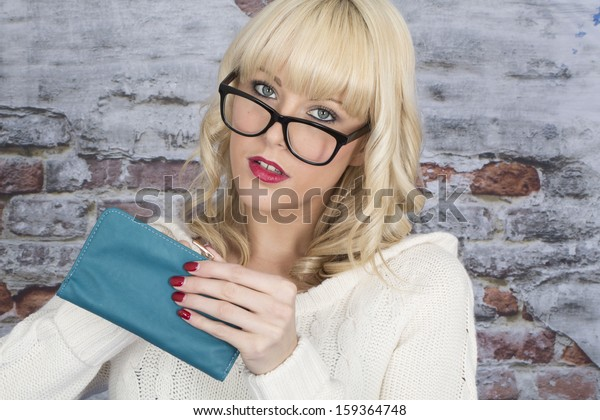 Model Released. Attractive Young Woman Holding a Purse