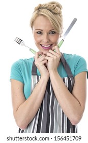 Model Released. Happy Young Woman Holding Knife and Fork
