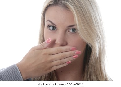 Model Released.  Young Woman Covering Her Mouth