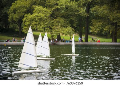 Model sailboats sailing on conservatory water in Central Park in New York City