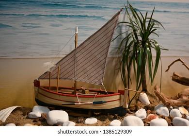 Model sailing ship on the sand