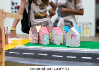 Model of a smart city for children. IT education activities through the programming of a microntoroller to control the lights and the infrastructures of a model of city. Coding activities for children