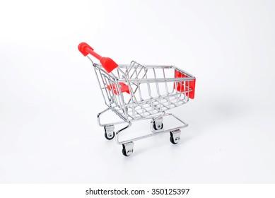 Model of supermarket trolley on white background.