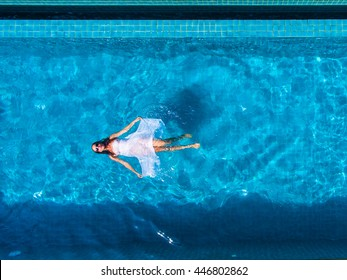 Model In swimming pool aerial view