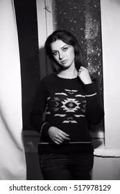 Model test shoot black and white portrait.  girl in the interior