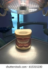 Model of tooth with spotlight at dental chair in dental clinic