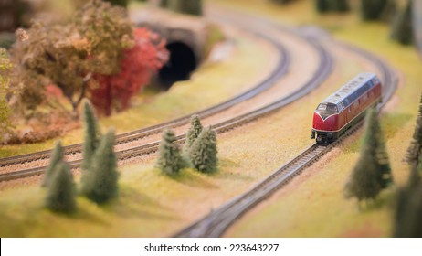 Model trains in an miniature goods yard,Red trains ,Autumn color