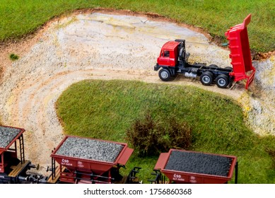 Model truck in scale H0 on train layout in stone pit