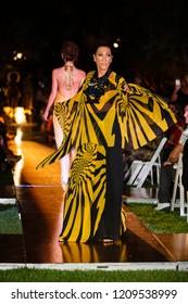 A model walks the runway during the Alexis Carballosa Spring Summer 2019 Fashion Show at the Miami Beach Botanical Garden in MIami Beach, Florida on October 18th, 2019