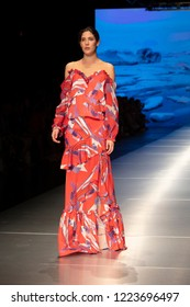 A model walks the runway during the Carolina Estefan Fashion Show Resort 2018 Collection in Miami Fashion Week 2017 at the Ice Palace in Miami on June 2nd, 218