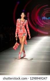 A model walks the runway during the Custo Barcelona Fashion Show Resort 2018 Collection in Miami Fashion Week 2017 at the Ice Palace in Miami on June 2nd, 2018