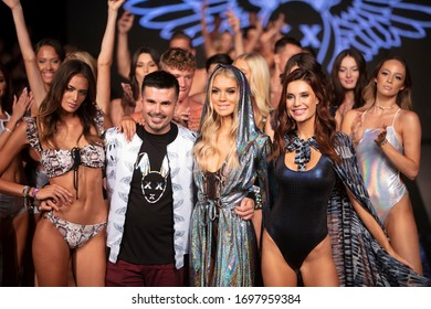 A model walks the runway during the Mister Triple X Fashion Show Summer 2019 collection during Art, Hearts and Fashion Swim 2018 at the Faena Forum in Miami Beach on July 15th, 2019