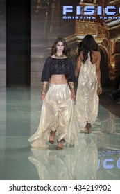 A model walks the runway for Fisico by Cristina Ferrari Resort 2016 Collection Fashion Show during Miami Fashion Week 2016 at the Ice Palace in Miami on June 2nd, 2016