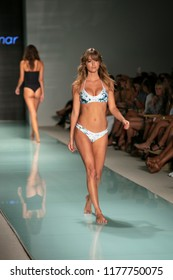 A model walks the runway for Issa de Mar Summer collection 2018 fashion show during Funkshion Swim 2017 in Miami Beach at the Setai Hotel on July 23rd, 2017