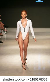 A model walks the runway for T Rivera Summer collection 2018 fashion show during Art Hearts Fashion Swim 2019 in Miami Beach at the Faena Forum on July 13th, 2018