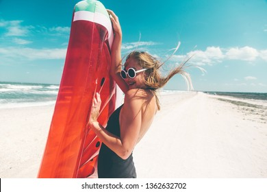 Model with watermelon lilo at the beach. Summer vacations, idyllic scene.