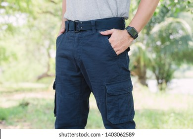 Model wearing blue   color cargo pants or cargo trousers