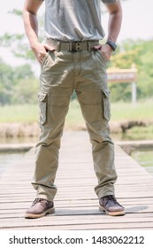 Model wearing sofe green color cargo pants or cargo trousers