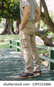 Model wearing yellow brown  color cargo pants or cargo trousers