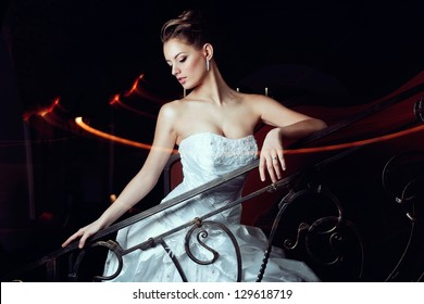Model in a wedding dress on the stairs