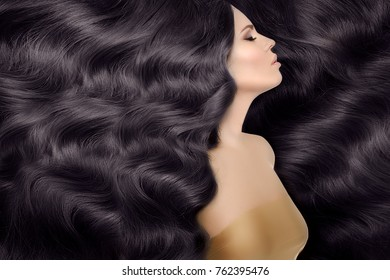 Model, woman with long black healthy shiny volume hair. Waves Curls Hairstyle.  Salon. Updo. Fashion model.  Girl with luxurious haircut.