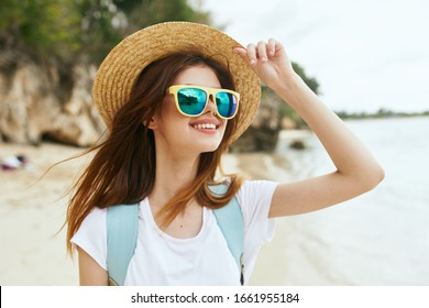 model woman in a straw hat in the fresh air