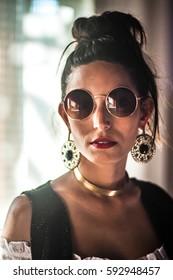Model woman, young, brazilian, brunette, black hair, brown eyes, lean, posing outdoors
