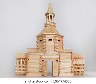 Model of a wooden castle made of matches