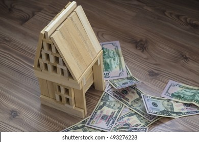 model wooden house and dollar