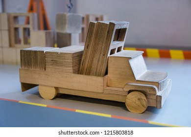 model of wooden truck loaded with windows toy car.