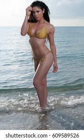 Model in a yellow bikini at a Florida Beach.