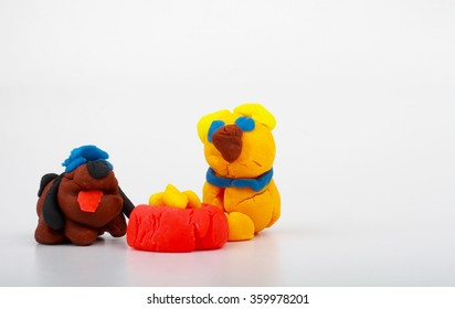 modeling clay dog and cat eating at the same bowl