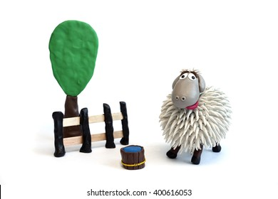 Modeling clay sheep farm on white background