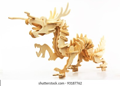Modeling a dragon statue  made of plywood, isolated on a white background.