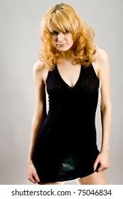 modeling girl in a black dress