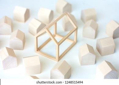 Models of miniature wooden houses with a big house in the center