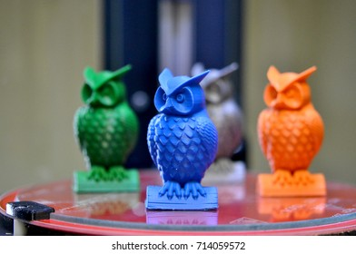 The models of owls created on the 3d printer stand on the desktop of 3d printer close-up. Progressive modern additive technologies 4.0 industrial revolution