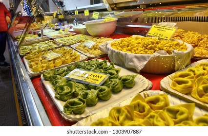 Modena, Emilia Romagna, Italy. December 2018. Albinelli Market, the historical market of the city. There are local gastronomic specialties. Gastronomy counter with filled pasta: cappelletti agnolotti.