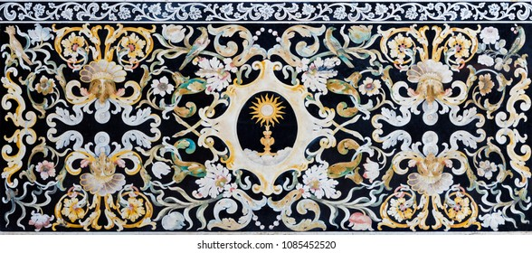 MODENA, ITALY - APRIL 14, 2018: The stone mosaic (Pietra Dura) with the Eucharist on the side altar in church Chiesa di San Bartolomeo from 16. - 17. cent.