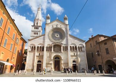 MODENA, ITALY - APRIL 14, 2018: The west facade of Duomo  (Cattedrale Metropolitana di Santa Maria Assunta e San Geminiano) at dusk.