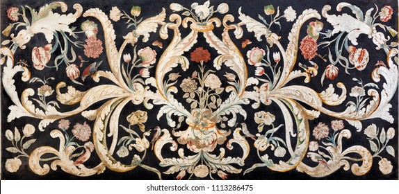 MODENA, ITALY - APRIL 14, 2018: The stone floral mosaic (Pietra Dura)  on the side altar in church Chiesa di San Bartolomeo from 16. - 17. cent.