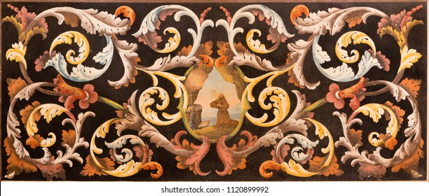 MODENA, ITALY - APRIL 14, 2018: The stone floral mosaic (Pietra Dura) with the St. Francis of Assisi at the prayer in church Chiesa di Santa Maria della Pomposa by Giovanni Pozzoli (1646-1734).