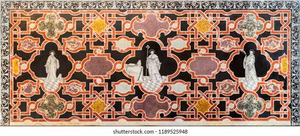 MODENA, ITALY - APRIL 14, 2018: The stone floral mosaic  (Pietra Dura) with  st. Mauro, Benedetto and Placido, in church Abbazia di San Pietro by Marco Mazelli (1690).